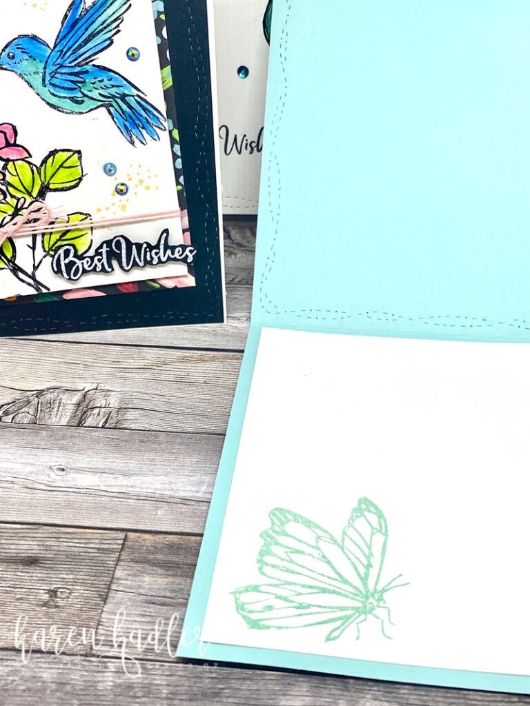 This picture shows the inside of a pool aprty blue card with a white insert. there is a beautiful butterfly stamped in blue.