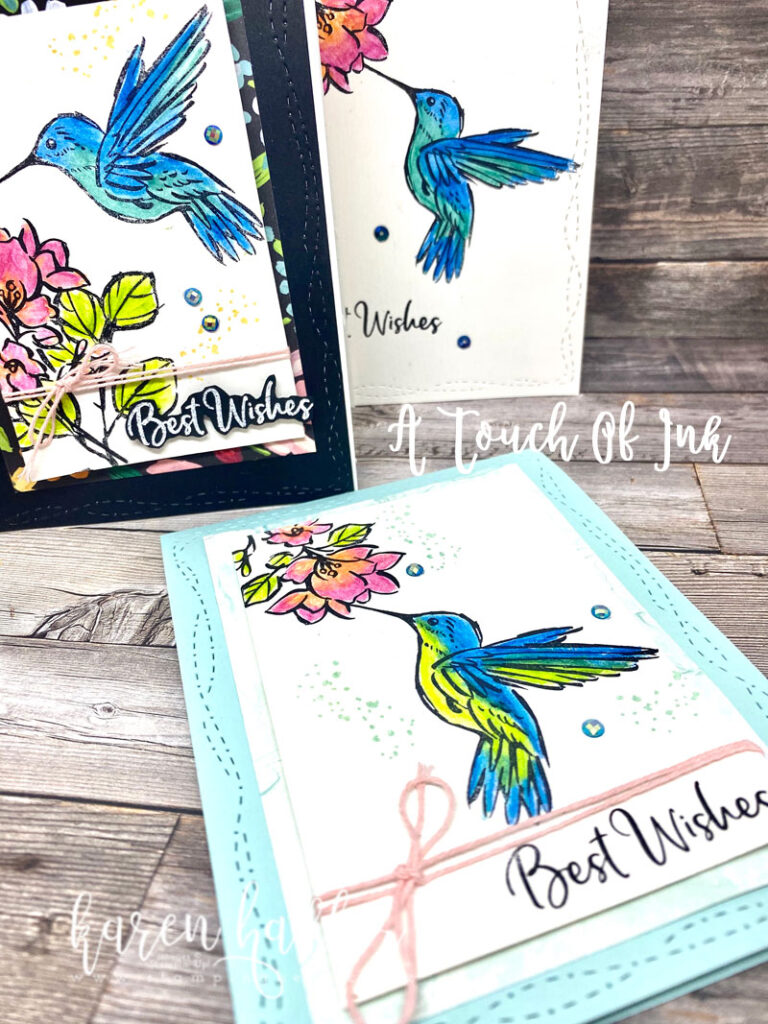 Showing 3 cards with bright watercoloured hummingbirds and flowers. The sentiment says Best wishes. The colours pop with blues greens oranges and pinks
