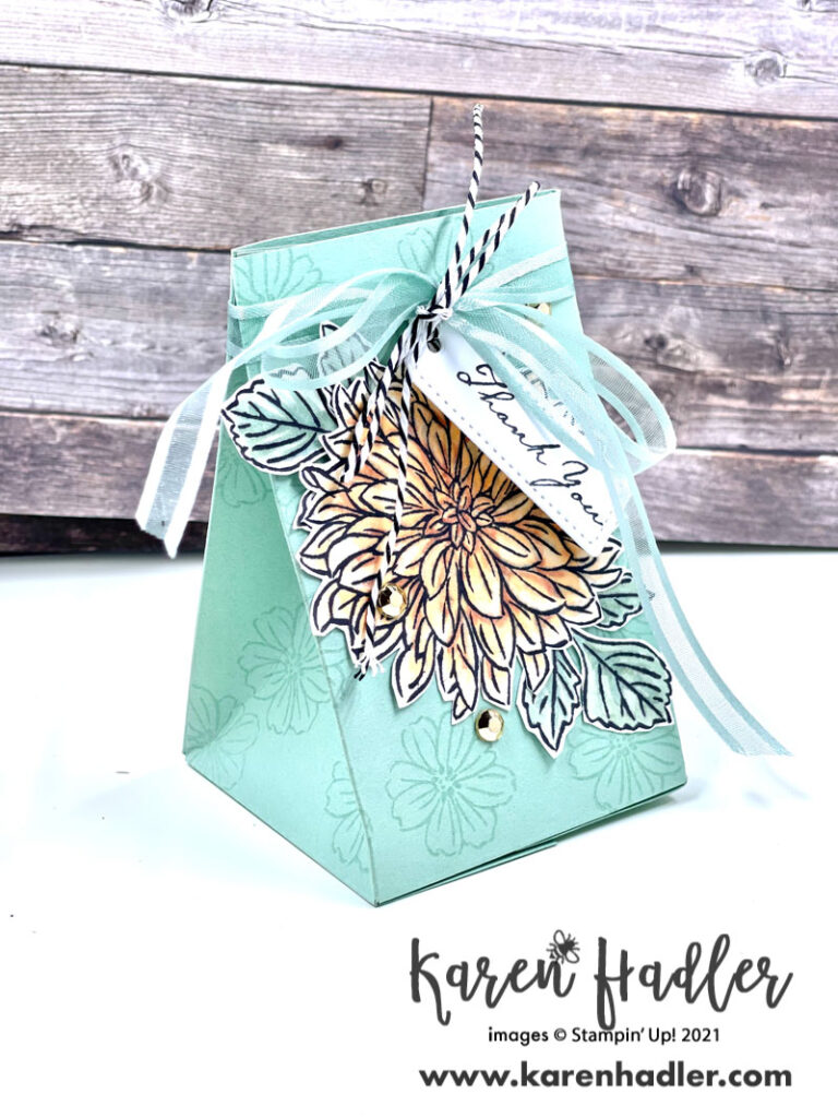 Delicate Dahlia Gift bag. Bag is in Mint macaroon with small flowers stamped on it. It is tied with a matching ribbon and has a small white tag stamped with Thank you. The main focus on the front is a large pale papaya coloured Dahlia.