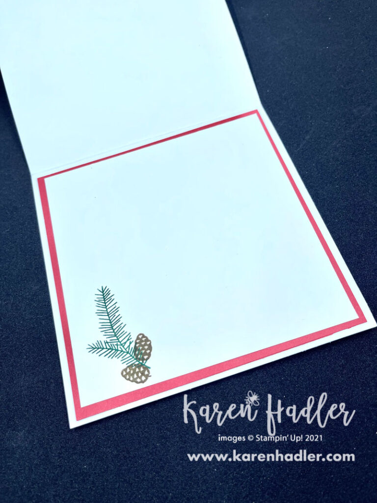 Sparkle of the season Card inside. There is a white card base and a red mat. On. the top white mat is a stamped pine needle with two pine cones at the bottom left corner.
