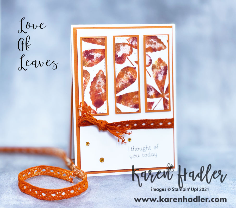 Love of Leaves. A picture showing textured and autumn coloured leaves on hand made DSP cut into 3 rectangles and placed vertically back with pumpkin pie card. The card base is white with a pumpkin pie matting an orange diamond lace ribbon tied around the middle and knotted. The sentiment is I thought of you today.